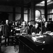 Black and white image of men in an office of past history