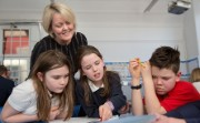 Alison Rose oversees 3 children at school learning